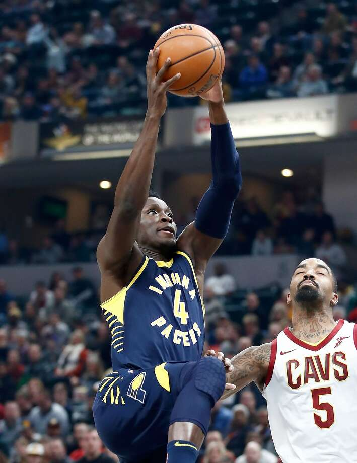cb14598bf8b4 Pacers guard Victor Oladipo rises over the Cavaliers  J.R. Smith for two of  his 33