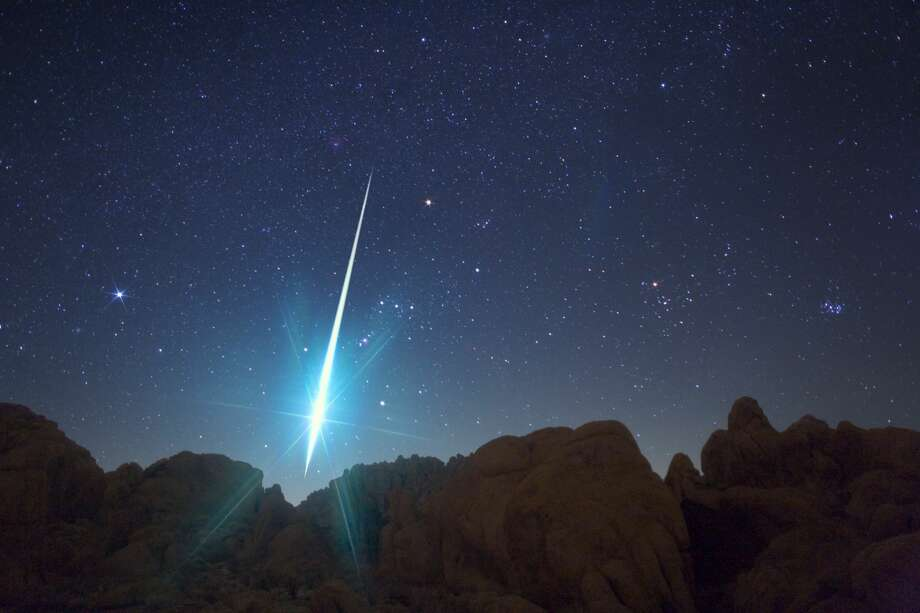 This incredible picture shows a huge meteor hurtling to Earth during the annual Geminid meteor shower on Dec. 14, 2009. Taken from the Mojave Desert area near Victorville under a very dark and mostly clear sky, astro-photogrpaher Wally Pacholka captured this amazing picture during the annual cosmic fireworks show. Photo: Barcroft/Barcroft Media Via Getty Images