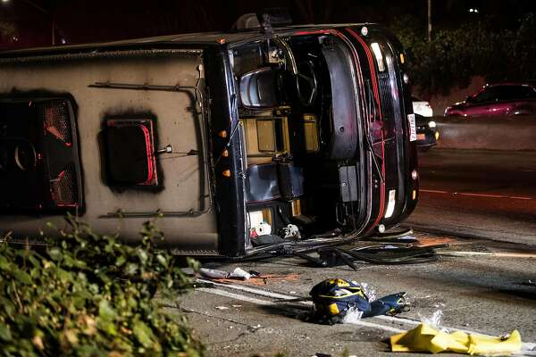 An overturned passenger bus is seen on southbound Highway101 north of Cesar Chavez Boulevard in San Francisco, Calif. on Friday, Dec. 8, 2017.