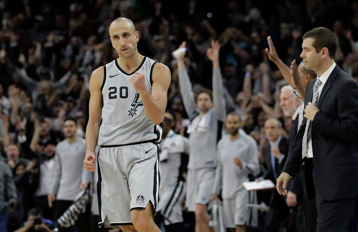 San Antonio Spurs guard Manu Ginobili (20) pumps his fist after hitting the winning shot in the final seconds of the team's NBA basketball game against the Boston Celtics, Friday, Dec. 8, 2017, in San Antonio. San Antonio won 105-102. (AP Photo/Eric Gay)