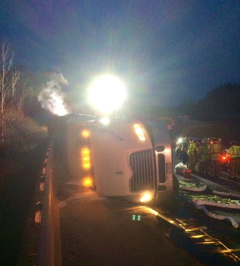 A tractor trailer containing 5,000 live chickens overturned on I-84 East around 6 a.m. Saturday morning. Photo: Connecticut State Police
