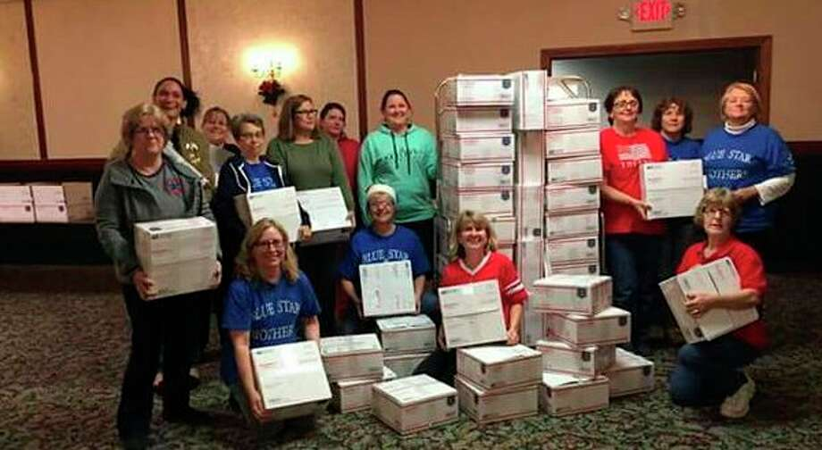 The Blue Star Mothers Thumb Chapter MI 178 and volunteers recently packed a total of 77 Christmas packages to send to our military troops. The chapter thanks The Franklin Inn, thecommunity and American Legion #499 for donations. (Submitted Photo)