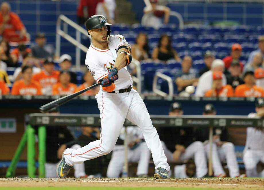 MIAMI, FL - SEPTEMBER 20:  Giancarlo Stanton #27 of the Miami Marlins hits his 56th home run of the season in the eighth inning against the New York Mets at Marlins Park on September 20, 2017 in Miami, Florida. Photo: Joe Skipper, Getty Images / 2017 Getty Images