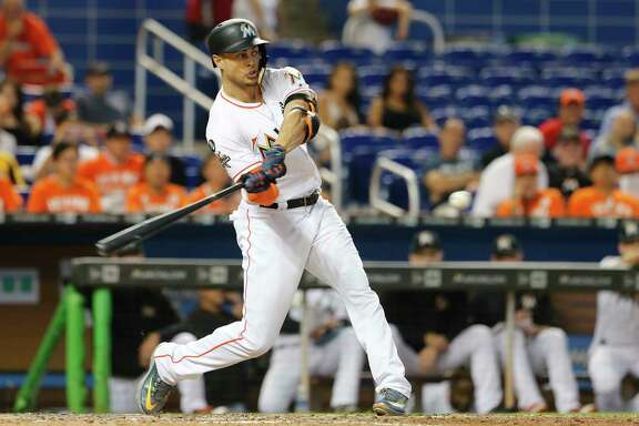 MIAMI, FL - SEPTEMBER 20:  Giancarlo Stanton #27 of the Miami Marlins hits his 56th home run of the season in the eighth inning against the New York Mets at Marlins Park on September 20, 2017 in Miami, Florida.