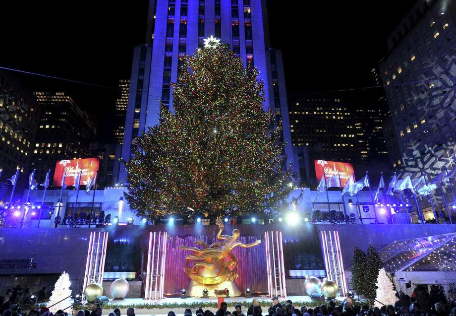 The Rockefeller Center Christmas Tree is covered with more than 50,000 multi-colored LED solar lights and will remain lit until Jan. 7, 2018. Photo: Diane Bondareff / Associated Press / AP Images