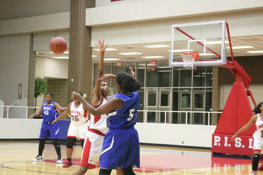South Houston's defense tries to knock this Westbury pass down as the team fought from behind to come away with a badly-needed win. Photo: Robert Avery