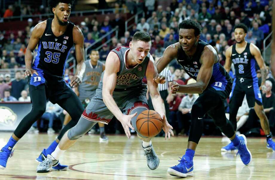 Boston College's Nik Popovic, center left, and Duke's Wendell Carter Jr, center right, chase a loose ball during the first half of an NCAA college basketball game in Boston, Saturday, Dec. 9, 2017. Photo: Michael Dwyer, AP / AP2017