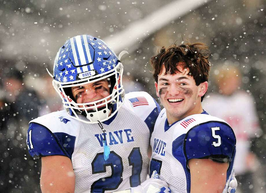 With snow falling all around them, Darien High School football players, Mitchell Pryor (#21), left, and quarterback Jack Joyce (#5) watched as the final seconds of the Class LL high school championship football game ticked off the clock giving Darien the state title as they defeated Greenwich High School, 31-22, at Boyle Stadium in Stamford, Conn., Saturday, Dec. 9, 2017. Photo: Bob Luckey Jr., Hearst Connecticut Media / Greenwich Time