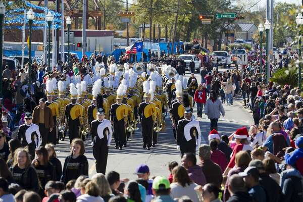 The Conroe High School band makes its way down Collins Street during the annual Conroe Christmas Celebration parade, Saturday, Dec. 9, 2017, in Conroe.