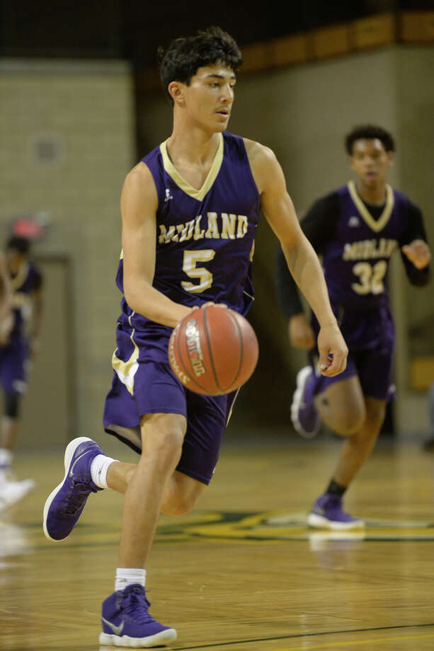 Midland High's Nathaniel Rodriguez (5) takes the ball down the court against Boswell in the Tall City Oilman's Invitational on Dec. 9, 2017, at Chaparral Center. James Durbin/Reporter-Telegram Photo: James Durbin