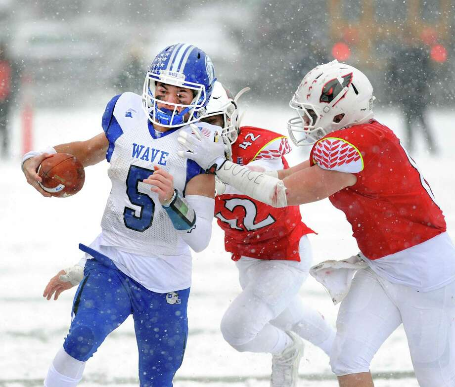 Darien quarterback Jack Joyce (#5) runs the ball during the Class LL high school championship football game between Greenwich High School and Darien High School at Boyle Stadium in Stamford, Conn., Saturday, Dec. 9, 2017. Darien took the state title defeating Greenwich, 31-22. Photo: Bob Luckey Jr. / Hearst Connecticut Media / Greenwich Time