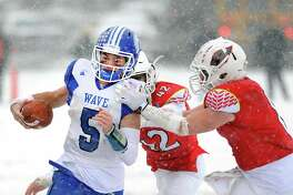 Darien quarterback Jack Joyce (#5) runs the ball during the Class LL high school championship football game between Greenwich High School and Darien High School at Boyle Stadium in Stamford, Conn., Saturday, Dec. 9, 2017. Darien took the state title defeating Greenwich, 31-22.