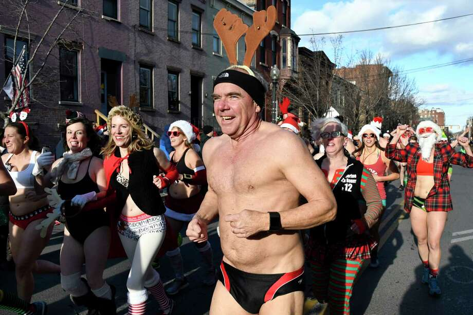Race participants run for the finish line during the 11th annual Santa Speedo Sprint on Saturday, Dec. 10, 2016, on Lark Street in Albany, N.Y. The 800-meter run, organized by the Albany Society for the Advancement of Philanthropy, raises funds for the Albany Damien Center and HIV/AIDS program at Albany Medical Center. (Cindy Schultz / Times Union) Photo: Cindy Schultz / Albany Times Union