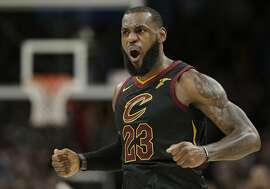 Cleveland Cavaliers' LeBron James celebrates after scoring in the second half of an NBA basketball game against the Sacramento Kings, Wednesday, Dec. 6, 2017, in Cleveland. The Cavaliers won 101-95. (AP Photo/Tony Dejak)