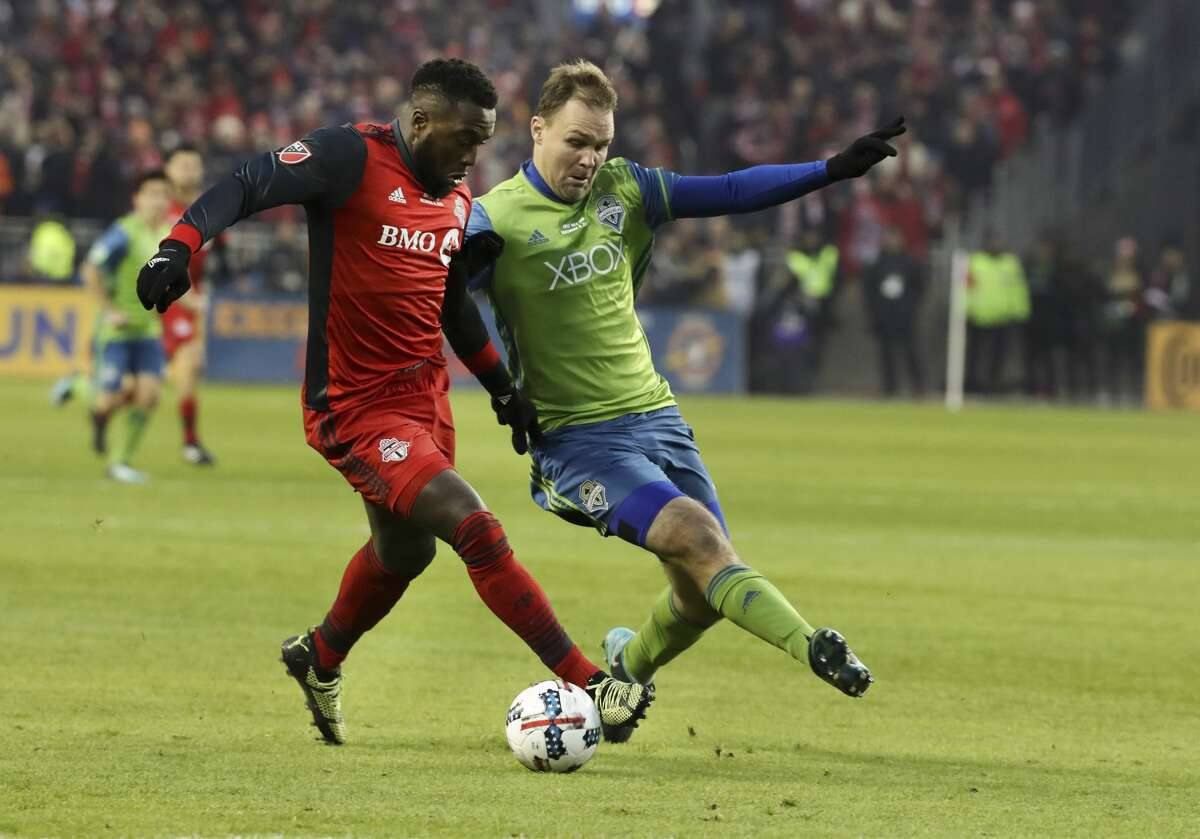 In first half action, Toronto FC forward Jozy Altidore (17) battles with Seattle Sounders defender Roman Torres (29) for the ball. The TFC (Toronto Football Club) took on the Seattle Sounders in the MLS Cup Final at BMO field in Toronto. It is the second year in a row the two faced off in the final.