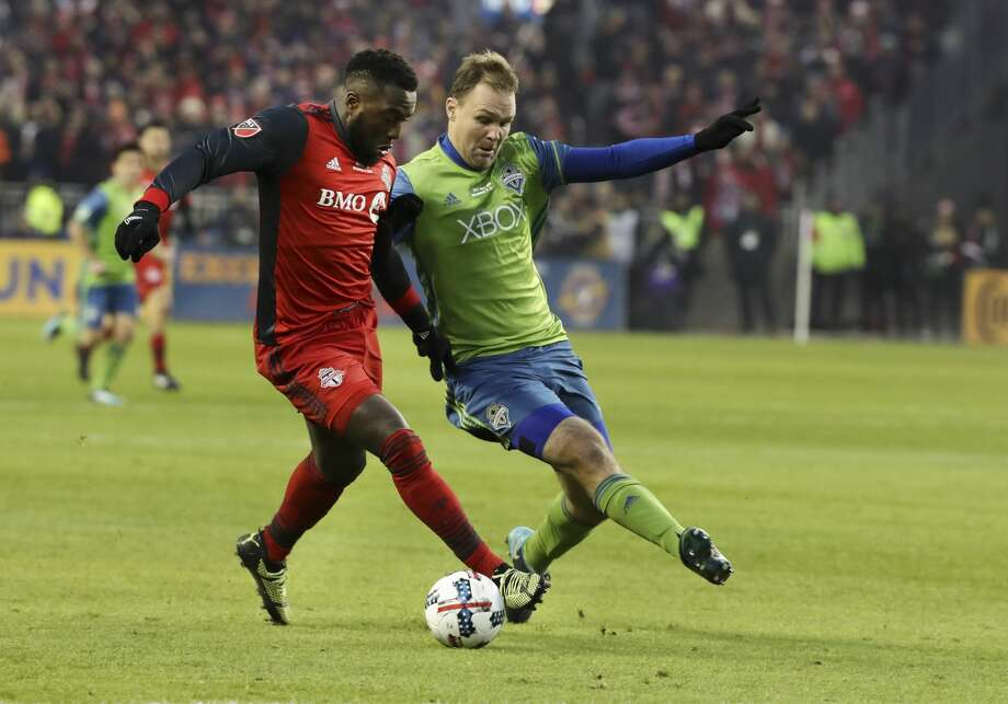In first half action, Toronto FC forward Jozy Altidore (17) battles with Seattle Sounders defender Roman Torres (29) for the ball. The TFC (Toronto Football Club) took on the Seattle Sounders in the MLS Cup Final at BMO field in Toronto.  It is the second year in a row the two faced off in the final. Photo: Richard Lautens/Toronto Star/Getty Images