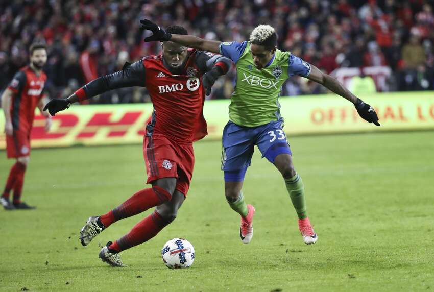 In first half action, Toronto FC forward Jozy Altidore (17) and Seattle Sounders defender Joevin Jones (33) battle for the ball. The TFC (Toronto Football Club) took on the Seattle Sounders in the MLS Cup Final at BMO field in Toronto.