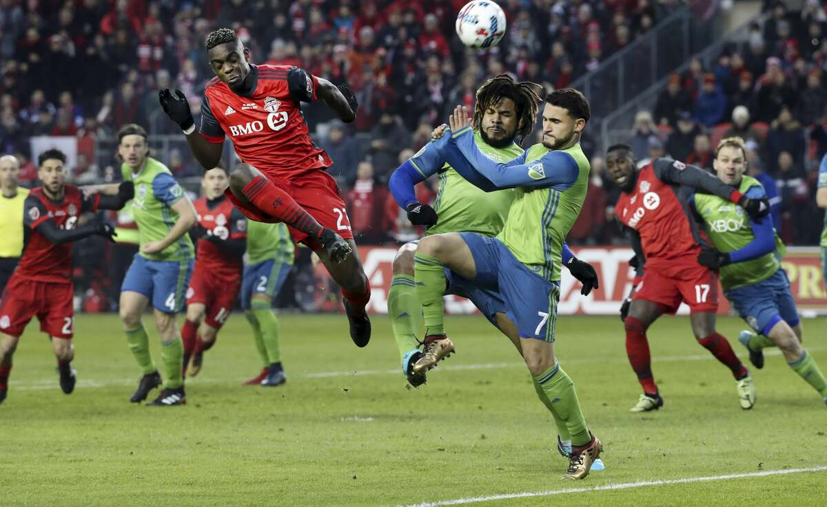 In first half action, Toronto FC defender Chris Mavinga (23) puts the ball towards the net around a lot of traffic. The TFC (Toronto Football Club) took on the Seattle Sounders in the MLS Cup Final at BMO field in Toronto. It is the second year in a row the two faced off in the final.
