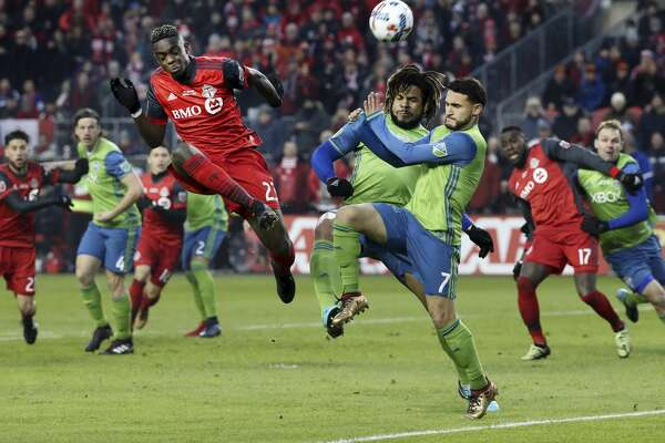 TORONTO, ON - DECEMBER, 9   In first half action, Toronto FC defender Chris Mavinga (23) puts the ball towards the net around a lot of traffic. The TFC (Toronto Football Club) took on the Seattle Sounders in the MLS Cup Final at BMO field in Toronto.  It is the second year in a row the two faced off in the final. Soccer, pitch, ball, championship, players, team sport December, 9 2017