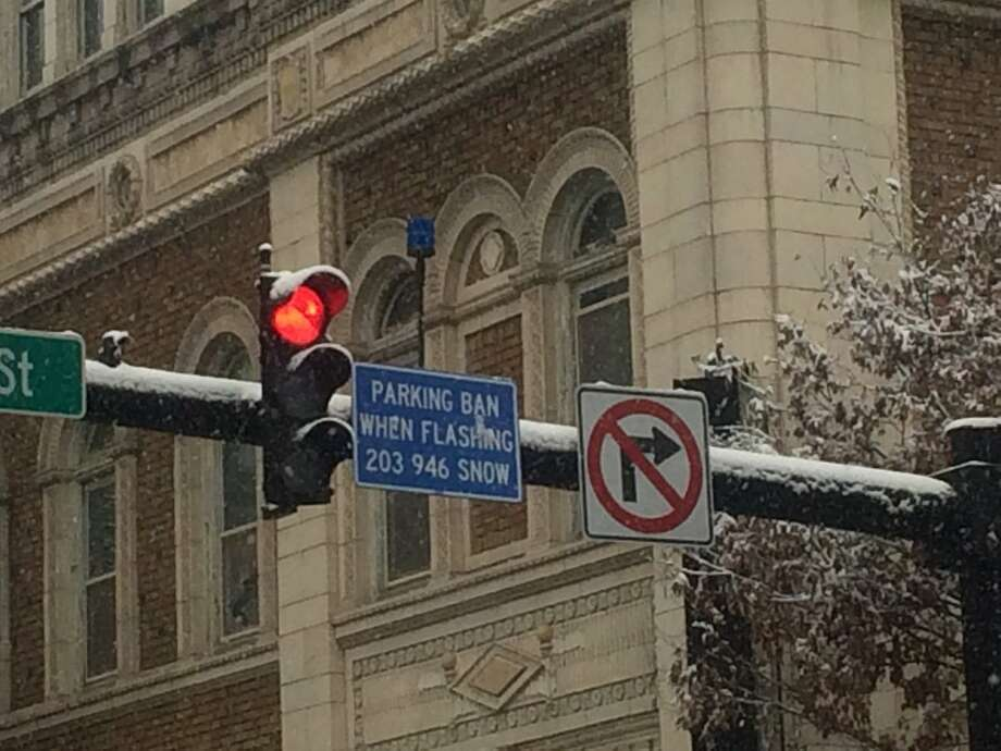 Keep an eye out for the flashing blue light over New Haven streets. If it is blinking, there is a parking ban. Photo: Bill Kaempffer / Hearst Connecticut Media