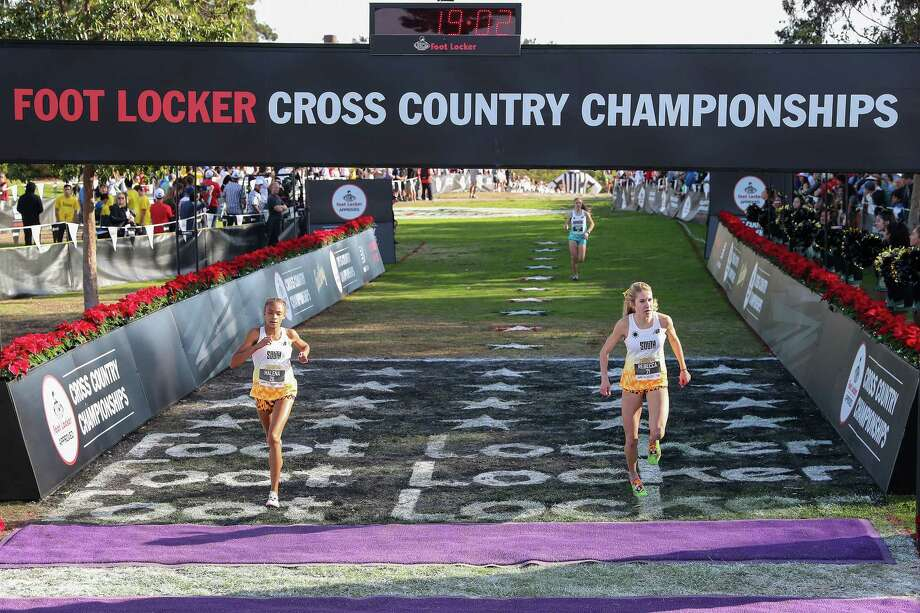 611f16d4e637d Montgomery s Halena Rahmaan crosses the finish line at the Foot Locker  Cross Country Championships in San