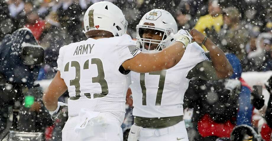 PHILADELPHIA, PA - DECEMBER 09:  Darnell Woolfolk #33 of the Army Black Knights celebrates his touchdown with teammate Ahmad Bradshaw #17 in the first half against the Navy Midshipmen on December 9, 2017  at Lincoln Financial Field in Philadelphia, Pennsylvania.  (Photo by Elsa/Getty Images) Photo: Elsa/Getty Images