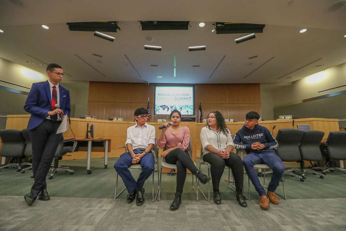 Antonio Arellano, from left, leads former HISD students Kleyder Sanchez, Jaquelin Sanchez, Jessica Chavez and Maykd Garcia in a panel discussion at HISD's third-annual Dream Summit on Saturday.