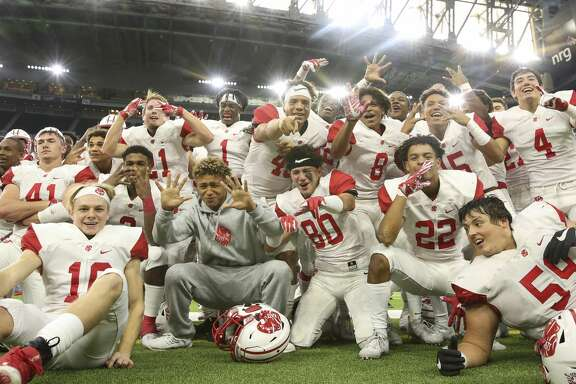 Katy players celebrating their regional championship after defeating North Shore at the Class 6A D1 quarterfinal game at NRG Stadium on Saturday, Dec. 9, 2017, in Houston. The Katy Tigers defeated the North Shore Mustangs 31-3. ( Yi-Chin Lee / Houston Chronicle )