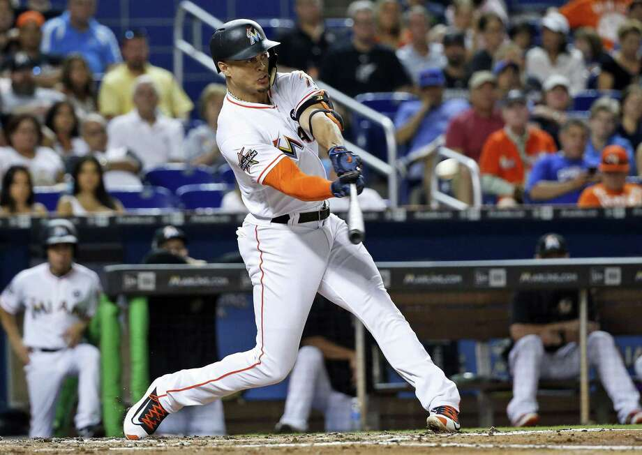 Reigning NL MVP Giancarlo Stanton's expected trade to the Yankees reminds Register reporter Chip Malafronte of when the Yankees acquired Alex Rodriguez. Photo: Wilfredo Lee / Associated Press / Copyright 2017 The Associated Press. All rights reserved.