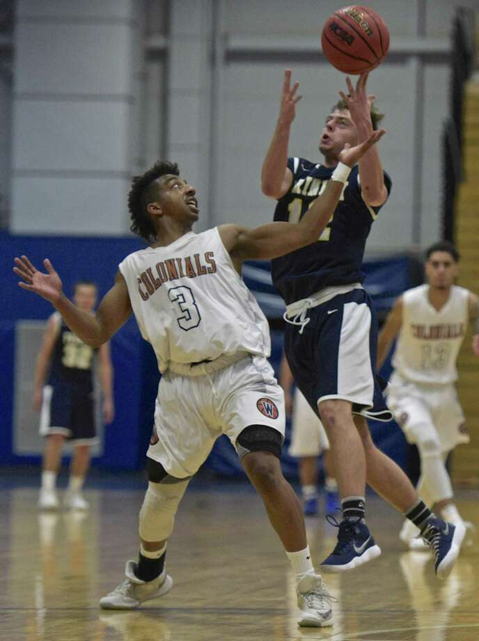 Westconn's Christian Porydez (12) and Trinity's Tyler Rowe (12)  fight over an inbounded ball during the Men's basketball game between Trinity College and Western Connecticut State University on Thursday night, November 30, 2017, at the O'Neil Center-Feldman Arena, Westside Campus of WCSU, in Danbury, Conn. Photo: H John Voorhees III / Hearst Connecticut Media / The News-Times