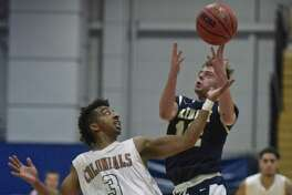 Westconn's Christian Porydez (12) and Trinity's Tyler Rowe (12)  fight over an inbounded ball during the Men's basketball game between Trinity College and Western Connecticut State University on Thursday night, November 30, 2017, at the O'Neil Center-Feldman Arena, Westside Campus of WCSU, in Danbury, Conn.