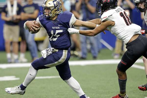 Panther quarterback Roel Sanchez breaks for the open field past Jeremiah Patterson as O'Connor plays Lake Travis in the Class 6A Division I state quarterfinals at the Alamodome December 9, 2017
