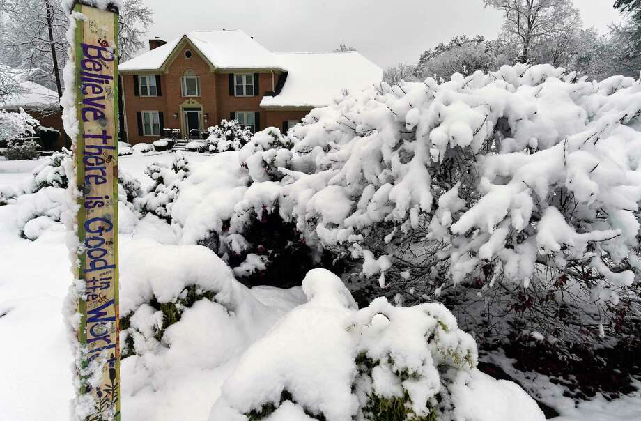 Heavy snow weighs down shrubs in front of a home, Saturday, Dec. 9, 2017, in Kennesaw, Ga. The frigid temperatures behind a cold front combined with moisture off the Gulf of Mexico to bring unusual wintry weather to parts of the South. (AP Photo/Mike Stewart) Photo: Mike Stewart, STF / Copyright 2017 The Associated Press. All rights reserved.