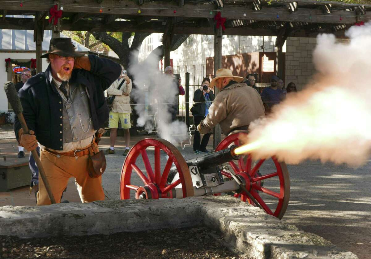 Texians Pad Kelly (left) and Jim Price fire a 2-pound cannon during the San Antonio Living History Association's re-enactment of the Battle of Béjar and the capitulation of Mexican Gen. Martín Perfecto de Cos at La Villita on Saturday.
