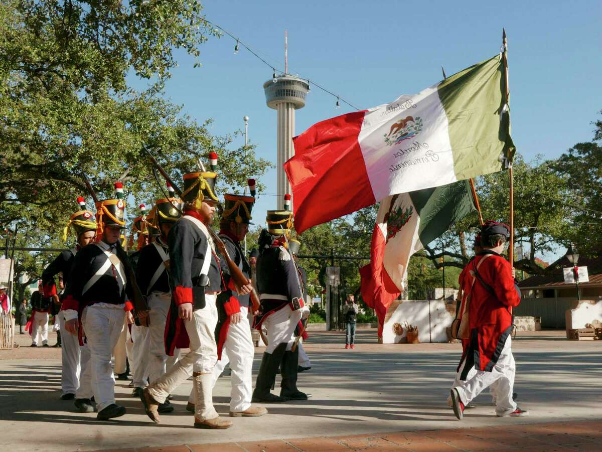 The Mexican Army troops of Gen. Martin Perfecto de Cos march iin the capitulation ceremony after their defeat during the San Antonio Living History Association's re-enactment of the Battle of Bejar and the general's surrender on Saturday, Dec. 9, 2017. The events depicted took place about three months before the Battle of the Alamo.