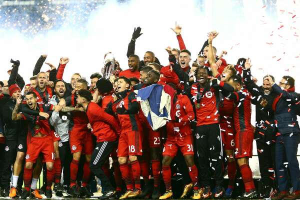 TORONTO, ON - DECEMBER 09:  Michael Bradley #4 of Toronto FC lifts the Championship Trophy after winning the 2017 MLS Cup Final against the Seattle Sounders at BMO Field on December 9, 2017 in Toronto, Ontario, Canada.  (Photo by Vaughn Ridley/Getty Images)