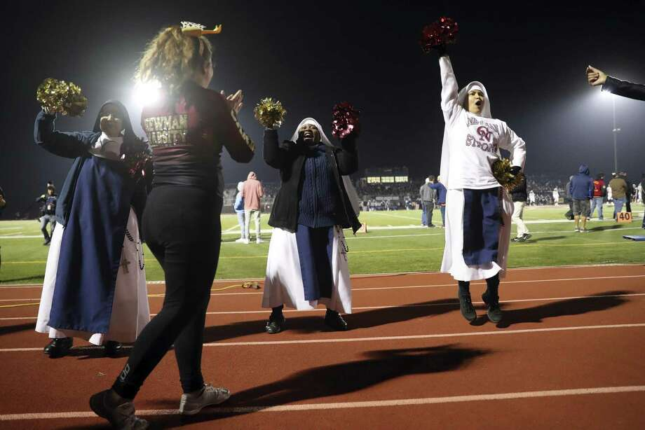 Cardinal Newman's Sister Mary Victoria (left), Sister Mary Rose and Sister Michelle Murray join cheerleaders during the Cardinals' 59-56 loss to Marin Catholic in the North Coast Section Division 3 football championship game. Photo: Scott Strazzante / The Chronicle / San Francisco Chronicle