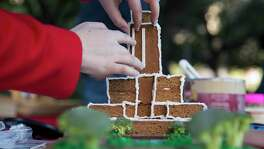 Members of IBI Group's gingerbread house team add details to the facade of city hall during Architecture Center Houston's 9th Annual Gingerbread Build-Off at City Hall on Saturday, Dec. 9, 2017, in Houston. The team recreated a scene from the Astros parade. (Annie Mulligan / Freelance)
