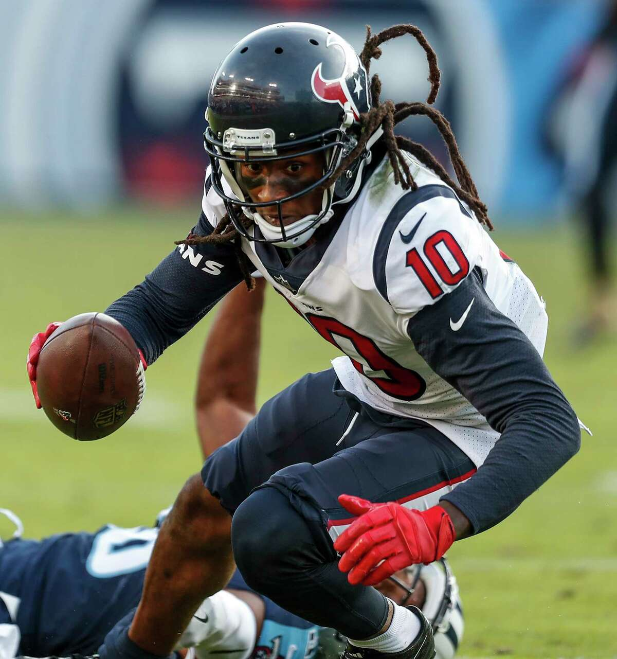 Houston Texans wide receiver DeAndre Hopkins (10) turns upfield after making a catch against the Tennessee Titans during the fourth quarter of an NFL football game at Nissan Stadium on Sunday, Dec. 3, 2017, in Nashville. ( Brett Coomer / Houston Chronicle )