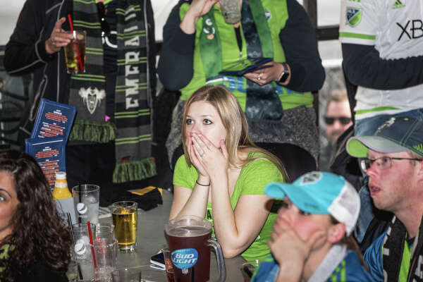 Seattle Sounders fans react as Toronto FC scores in the second half of the MLS Cup Final in Toronto, at Fuel Sports in Pioneer Square on Saturday, Dec. 9, 2017.