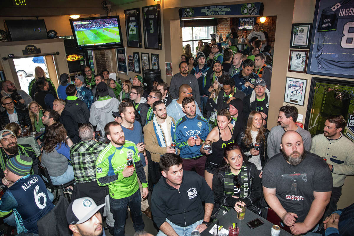 Seattle Sounders fans watch their team take on Toronto FC at Fuel Sports in Pioneer Square on Saturday, Dec. 9, 2017.