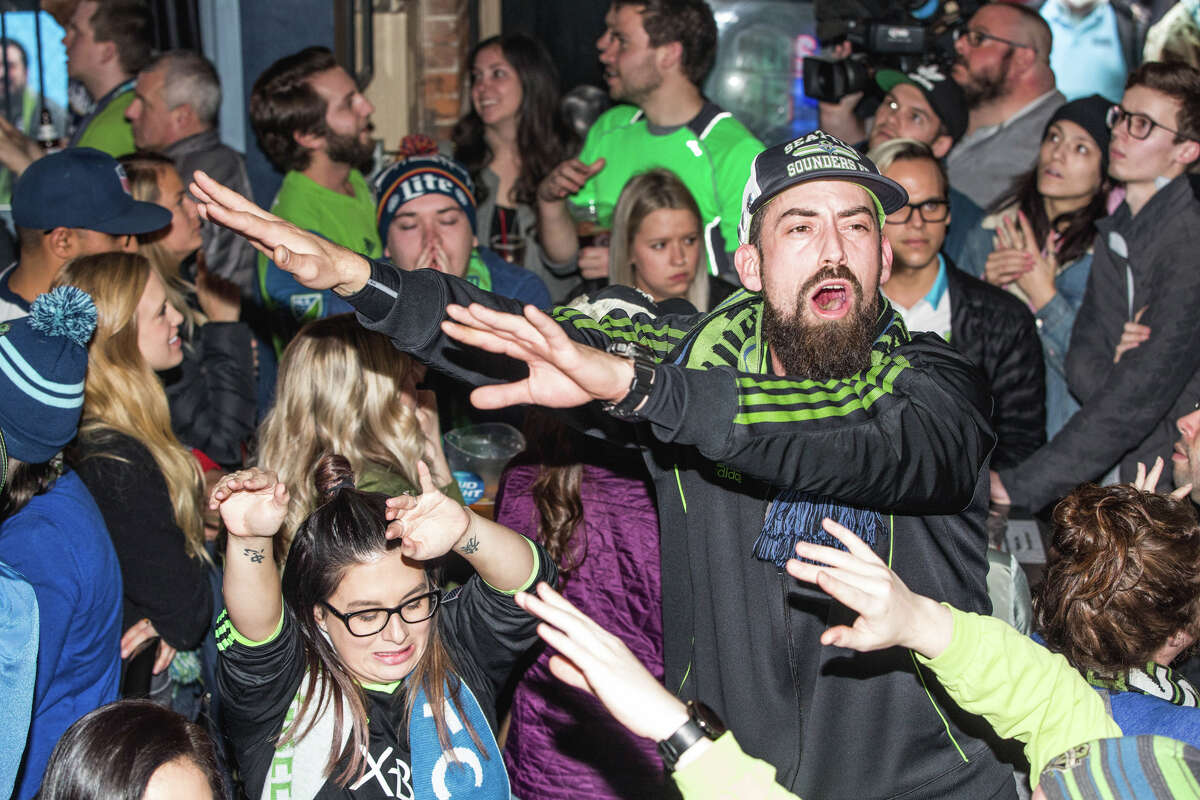 Seattle Sounders fans cheer as their team takes on Toronto FC at Fuel Sports in Pioneer Square on Saturday, Dec. 9, 2017.