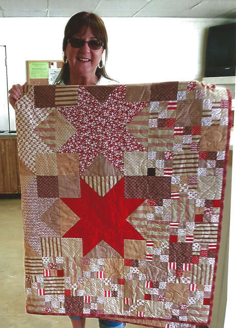 Carolyn Connely is the winner of the 2017 Thankgiving quilt drawing held on Nov. 16 at the Kenefick Activity Club's Thanksgiving dinner. Photo: Submitted