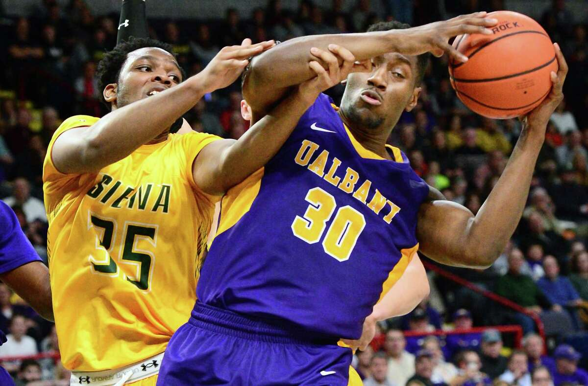 Siena's Sammy Friday, left, and UAlbany's Travis Charles tangle during their Albany Cup game at the Times Union Center on Saturday, Dec. 9, 2017, the last time the game was played. (John Carl D'Annibale / Times Union)