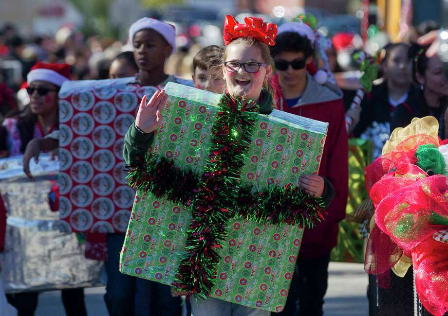 Jayde Sindelar takes part a parade during the annual Conroe Christmas Celebration, Saturday, Dec. 9, 2017, in Conroe. Photo: Jason Fochtman, Staff Photographer / © 2017 Houston Chronicle