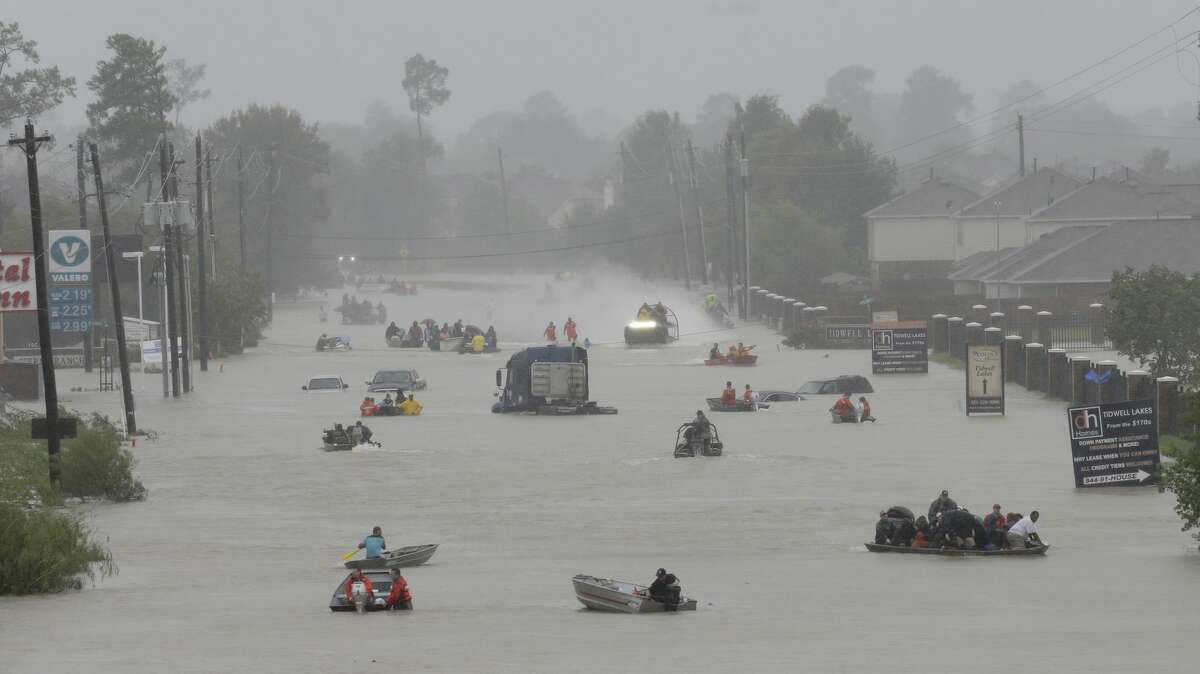 Rescue boats of every shape, manner and size make their way along Tidwell near the east Sam Houston Tollway. Moving people to safety included first responder and volunteer efforts.