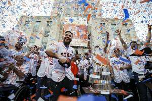 Star second baseman Jose Altuve joyfully tosses a World Series cap into the crowd in front of City Hall during the celebration honoring the Astros and their world championship. Confetti rained over the team – and Gov. Greg Abbott, appropriately attired in an Astros jersey – and for a moment obscured the trophy that eluded the organization since becoming a major league team in 1962.