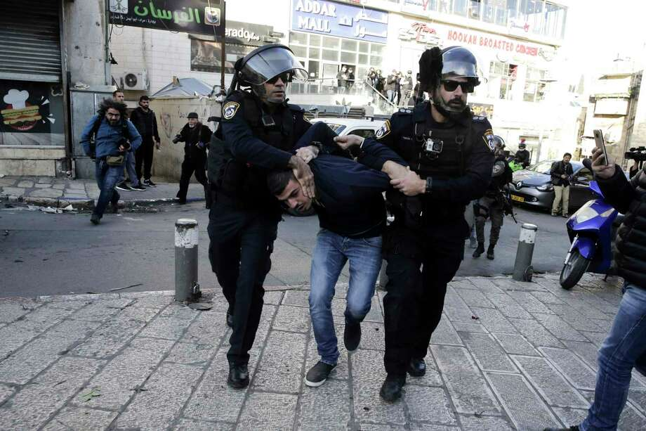 Israel police arrest a Palestinian during a protest against U.S. President Donald Trump's decision to recognize Jerusalem as the capital of Israel in Jerusalem, Saturday, Dec.9, 2017.(AP Photo/Mahmoud Illean) Photo: Mahmoud Illean, STR / Copyright 2017 The Associated Press. All rights reserved.