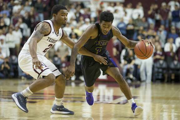 Prairie View A&M guard Gary Blackston (3) drives against Texas A&M guard TJ Starks (2) during the second half of an NCAA college basketball game Saturday, Dec. 9, 2017, in College Station, Texas. (AP Photo/Sam Craft)