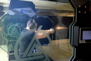 An Ally Outdoors employee shoots at the indoor 25-yard tactical range Dec. 9, 2017. James Durbin/Reporter-Telegram